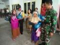 TNI Dan Polri Berpartisipasi Dalam Berbagi Di Hari Raya Paskah