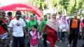 TNI Dan Persit Kodim Bojonegoro Ikuti Jalan Sehat, Wujudkan Pilkada Damai 2018