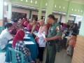 Koramil Bersama Dinkes Kediri Gelar Pengobatan Gratis Di Desa Pagung