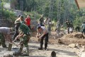 Sinergi TNI – Polri Dalam TMMD Ke-102 Di Desa Mojokerto
