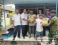 Koramil 0815/12 Ngoro Dampingi Pendistribusian Bantuan Benih Padi