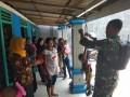 Babinsa Koramil 0814/07 Bantu Timbang Balita
